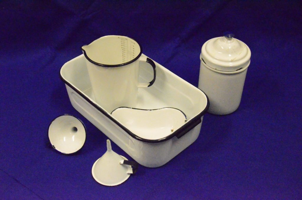 Enamelware funnels, measuring jug, kidney basin, dressings tray and container